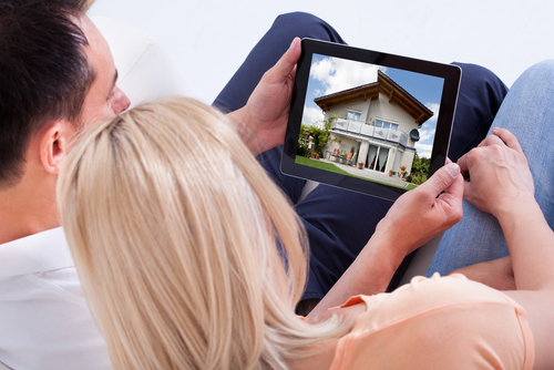 Couple Looking at Home on Tablet