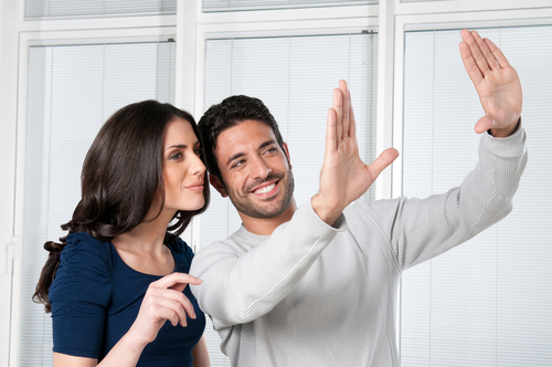Hispanic Couple Talking About Weston Luxury Homes