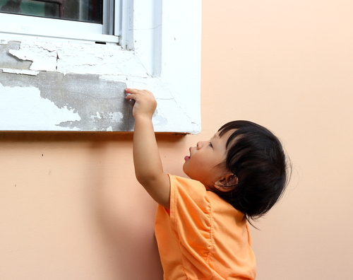Child Peeling Paint from Coral Gables Luxury Homes