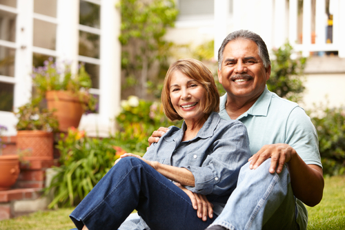 Retired Hispanic Couple Outside House